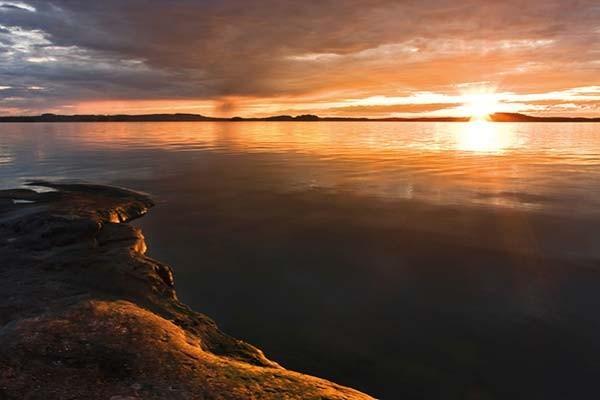 sentuntee_kuopion_energia_kaukolampo_lammin_bioenergia_luontoystavallinen_energia_auringonlasku_maisema_90-1